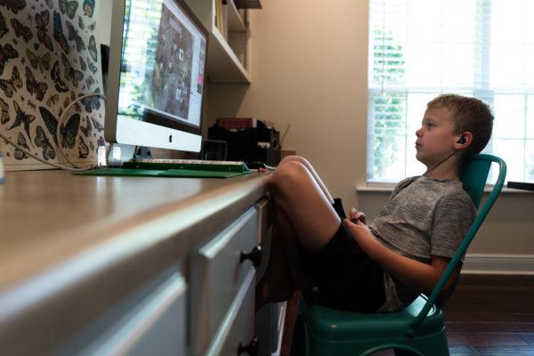 Homeschooling boy takes online class