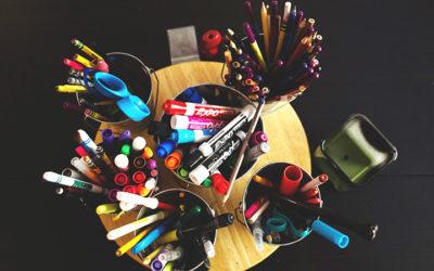 organized buckets in homeschool room