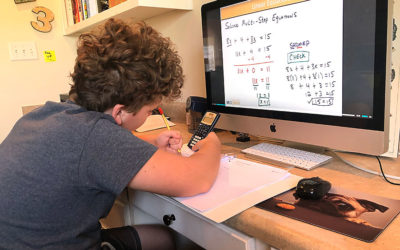 boy doing prealgebra on computer