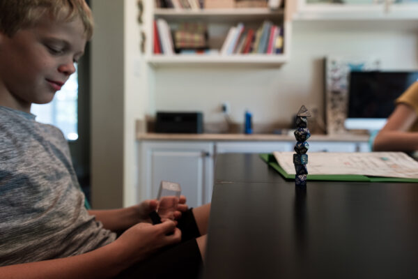 homeschool child playing with dice
