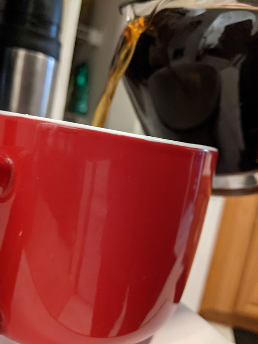 pouring coffee red cup