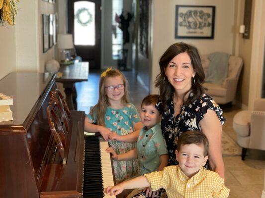 mom and children at piano