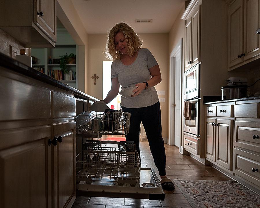 mom loading dishwasher
